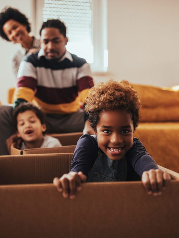 Parents and their children moving into a new house